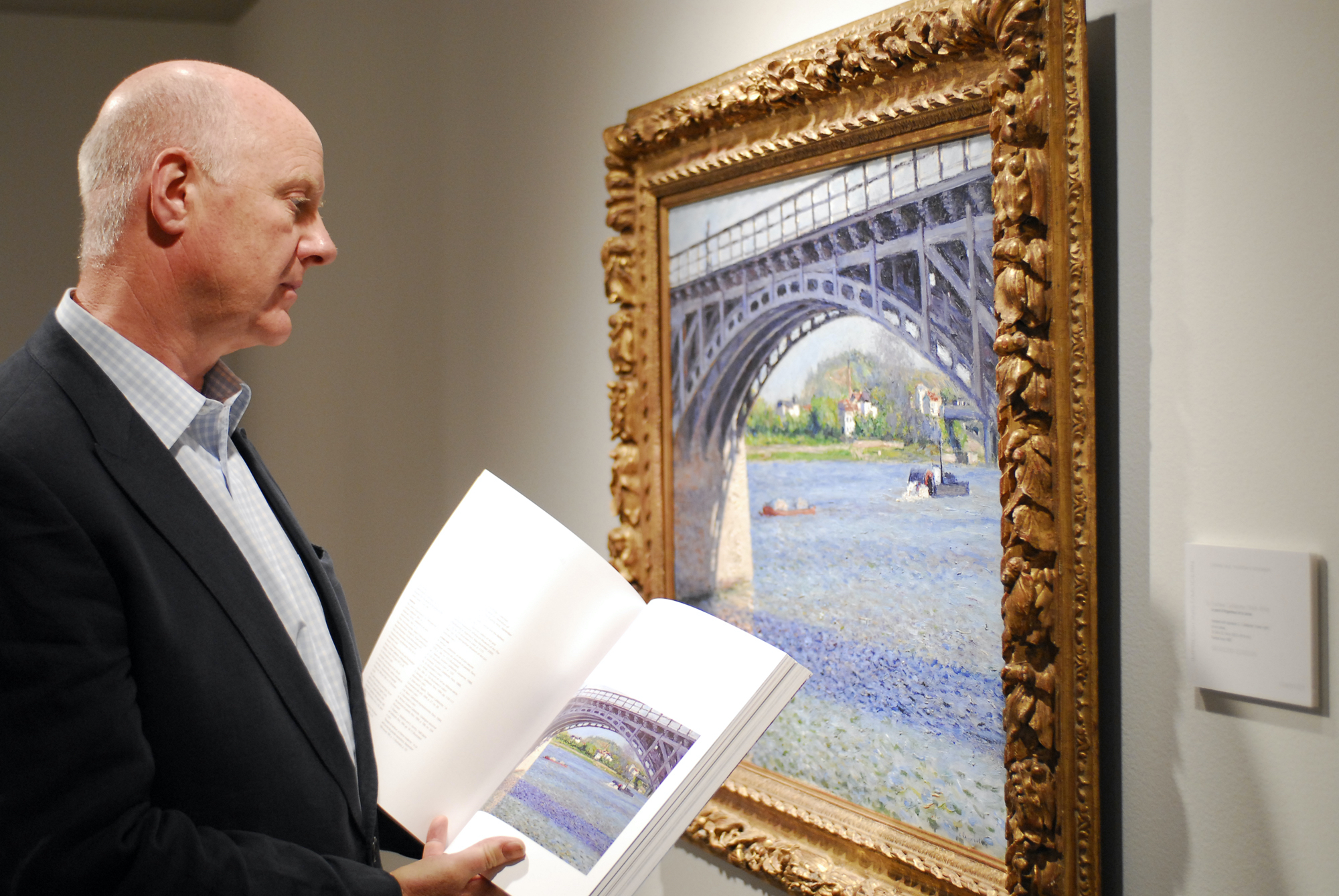 Ray Waterhouse viewing a painting