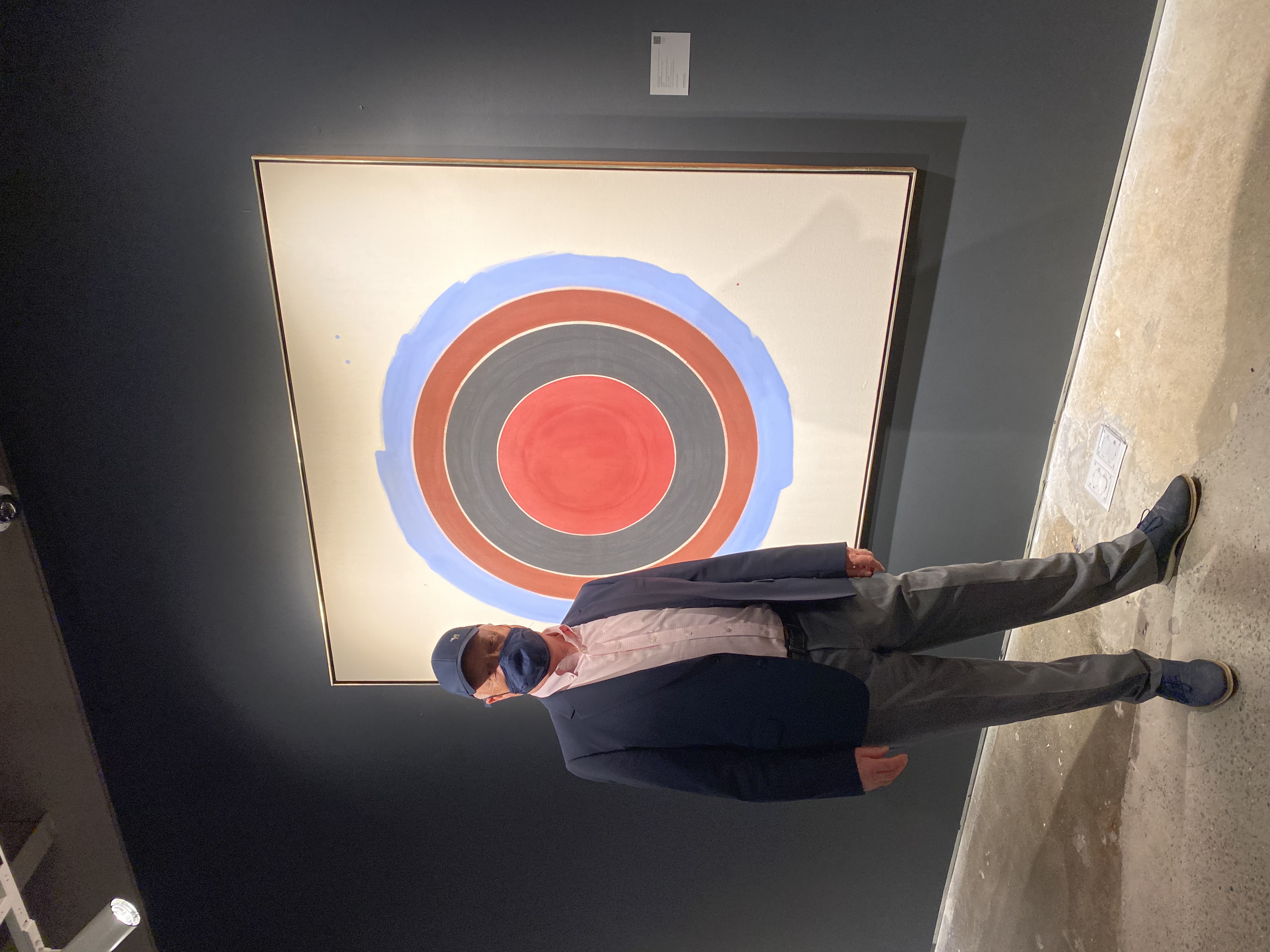 Ray Waterhouse in front of a painting