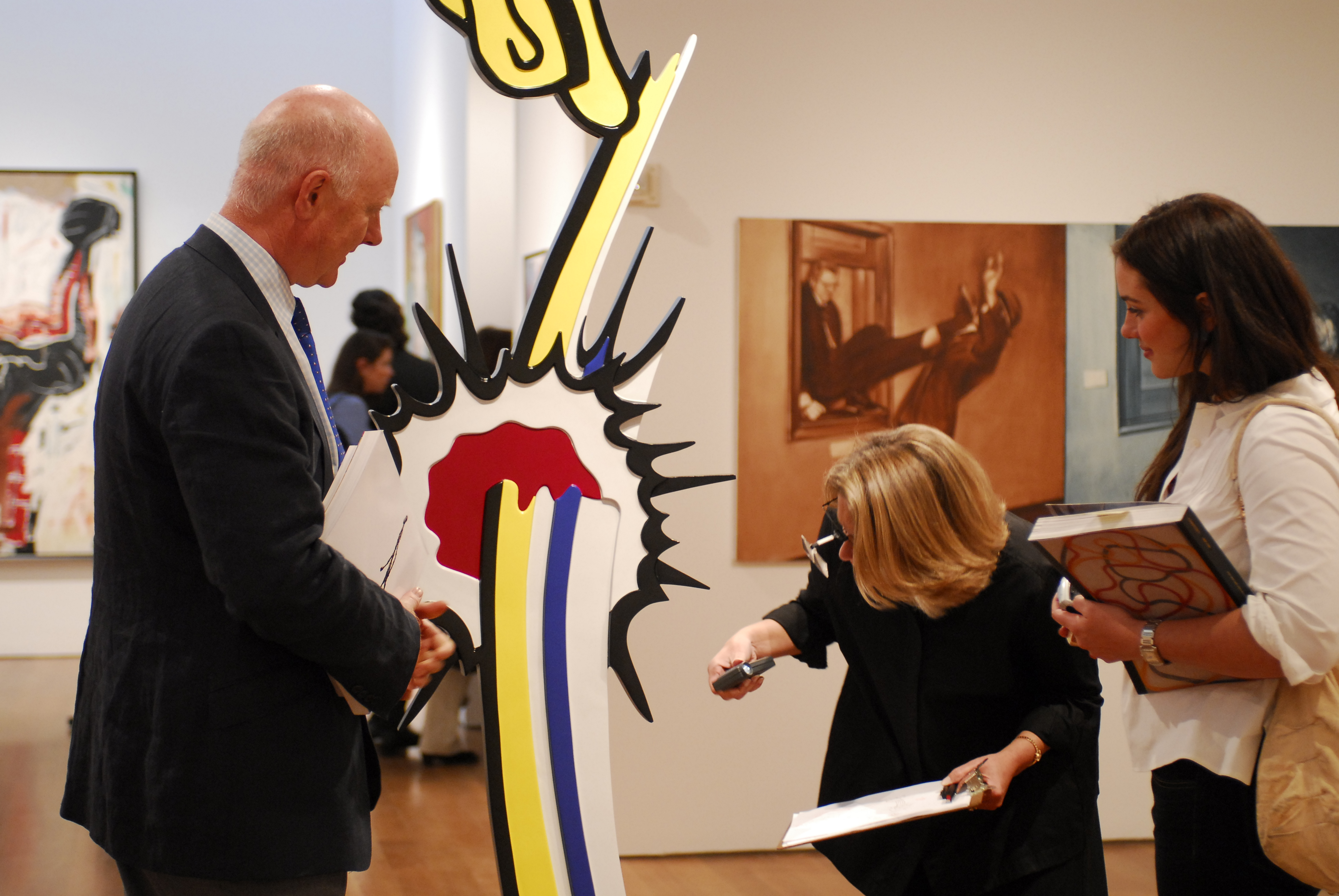 Ray Waterhouse examining a Roy Lichtenstein sculpture for a client