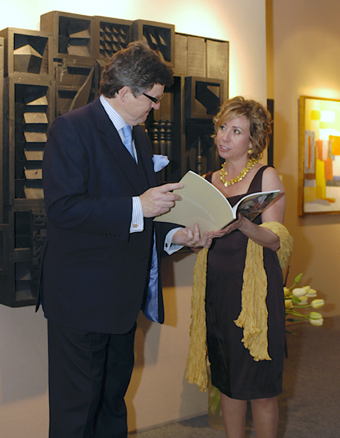 Jonathan Dodd discussing an artwork with another dealer